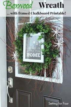 DIY Boxwood Wreath with Framed Chalkboard Printable and yarn snowflakes - perfect for your front door for winter! www.settingforfour.com