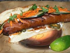 BANH MI HOT DOG Beef Grilled Hot Dog, Toasted Cheddar Jalapeno Bun, Mayo, Shredded Carrot, Cucumber, Cilantro and Lime