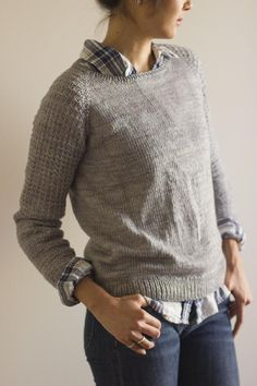 "Textured sleeves and straight lines make this classic, unisex pullover a perfect addition to the cool weather wardrobe.The pulloever is knit seamlessly from the top-down, in one piece, beginning at the neck. The top of the yoke is worked back and forth while the neck shaping takes place, then the remainder of the yoke, body and sleeves are worked in the round. Stitches for the collar are picked up and knitted at the end.Children's version found here.To be worn with 3""/7.5cm positive ..."