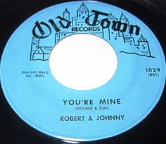 """1956 45 Rpm Robert & Johnny YOU'RE MINE / MILLION DOLLAR BILS On Old Town 1029.. A Bronx duo remembered for """"We Belong Together,"""" a beautiful harmony ballad that made the Top 40 in 1958, Robert Carr and Johnny Mitchell made about a dozen singles for the Old Town label in the late '50s and early '60s, none of which made remotely as much impact. As one-hit doo wop wonders go, though, they were more interesting than most."""