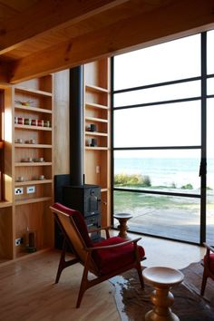 Tiny two stories holiday retreat on a sandy beach in New Zealand