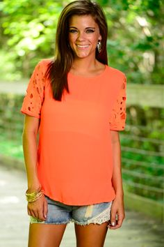This orange top is darling!! The loose fit and the open crochet sleeves are to die for! The exposed zipper in the back makes this beauty a must have!