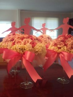 Ballerina birthday floral centerpieces.. Instead of ballerina I could put a number one!