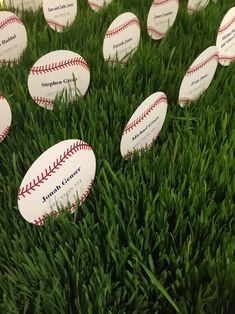 baseball shaped place cards displayed in real grass