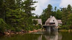 The Maine home resembles, on approach, a small fishing village. From the water side (above), you half expect to see locals pull up in a boat to wander around, procuring a fresh lobster in the process.