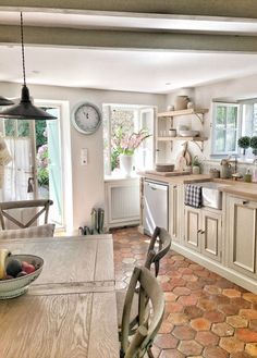 Kitchen. French farmhouse design inspiration, house tour, French homewares and market baskets from Vivi et Margot. Photos by Charlotte Reiss. Come be inspired on Hello Lovely and learn the paint colors used in these beautiful authentic French country inte