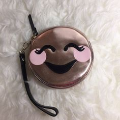 Kate Spade Tickled Pink Wristlet Kate Spade studio drive stassi coin purse with removable wristlet. Metallic faux nappa. Flat pouch. Says tickled pink on back. Rose gold color. Price firm. kate spade Bags Clutches & Wristlets