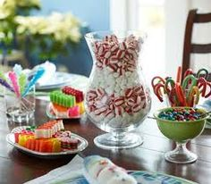 To make your dining room table look good, put some mints and candy canes in a glass bowl and some candy in smaller glass dishes.