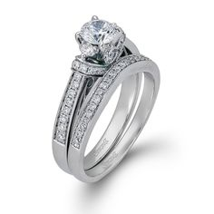 This gorgeous 18K white engagement ring and band is comprised of .42ctw round white Diamonds