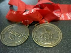 Mujer Araña Emilse Runner doble medalla finisher de la maratón de bs as 42km 2012