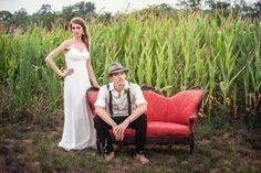 #farm wedding photography | bride & groom portrait on #vintage red sofa in a corn field | @haasweddings