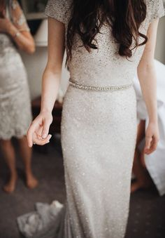 Sparkly sequin silver diamonte wedding dress with beautiful belt.