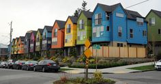 Colorful row of houses, street sign, N 35th and Meridian Ave N, Seattle, Washington, USA