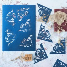 Laser cut corners. Navy laser cut panels for decorating wedding invitations and DIY wedding stationery.