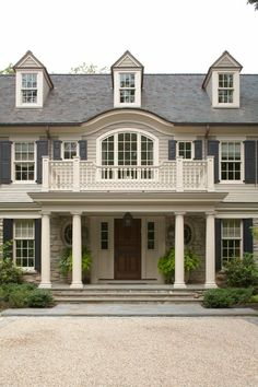 Daniel Contelmo Architects in NY. . . .  creamy white and blue/gray painted shutters