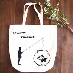 A big fish or a small man? Le Gros Poisson (The Big Fish) Tote Bag hand painted by Grafeeq Painted Bags, Hand Painted, Uni Bag, Cotton Tote Bags, Reusable Tote Bags, Gym Gear, Big Fish, Gym Wear