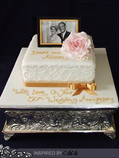 """This sweet 50th Wedding Anniversary cake. It was a 9"""" Fruitcake with a single large pink rose and a hand made frame with image of the happy couple. I Hope David and Alison have a wonderful day and enjoy this amazing milestone!! (Original concept by Inspired by Michelle Cake Designs)."""