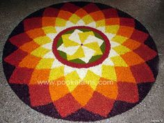 Onam Festival lasts for ten days and brings out the best of Kerala culture.View these 50 Best Pookalam Indian Floral Design and get your creative side going. Indian Rangoli Designs, Rangoli Designs Flower, Small Rangoli Design, Flower Rangoli, Beautiful Rangoli Designs, Kolam Designs, Rangoli Colours, Rangoli Patterns, Rangoli Ideas