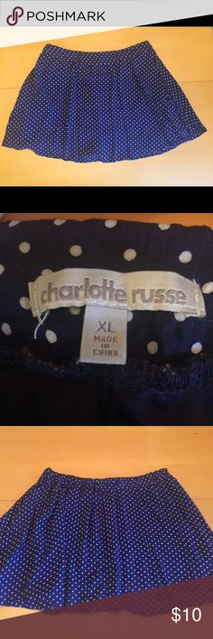 Charlotte Russe Dotted Skirt Navy blue with white dots. 16 inches in length. The front waistband is straight while the back is elastic. Flattering and bouncy. Size XL. I would recommend this for anyone in a size 10-16. It stretches a lot but the bigger you are the shorter it will be. Hardly worn. Charlotte Russe Skirts Mini