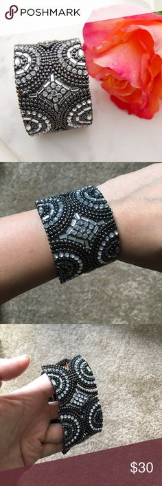 BANANA REPUBLIC Jeweled Bracelet/Cuff Stunning dark gray and clear jeweled bracelet/cuff. Elastic. Will come with a box. One or two strands of elastic has come undone but does not affect wear.   Instagram: @bringingupsuns Banana Republic Jewelry Bracelets