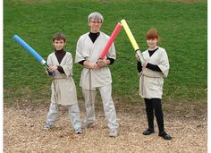 Easy, inexpensive, no sew Jedi robes!  My mom and I came up with this for my son's Star Wars party...easy robes for kids (and Dad!) made by purchasing over-sized t-shirts. Cut up the middle, fold collar under on each side and iron down with Stitch Witchery.  When you put it on, stick a round adhesive Velcro dot on the side to hold it shut and then we used dark brown macrame cord to tie it shut.  Viola!  Easy, inexpensive, no sew Jedi robes!