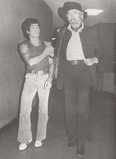 Bruce Lee and James Coburn. coburn was one of lee's jeet kune do students.