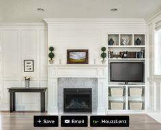 Fireplace with asymmetrical bookshelf