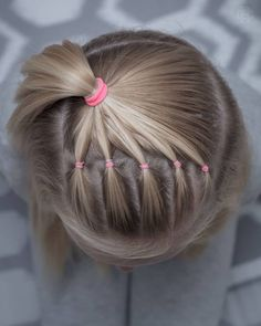 This is a style i did for school last week  Cloe wanted her hair down so i just tied it back into a few pink elastics to keep her hair…