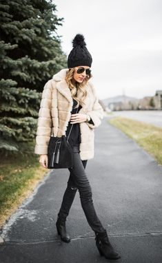 Christine Andrew is rocking the fur coat trend! Through pairing a vintage style faux fur with a black sweater and matching jeans, this otherwise simple look is given a glamorous twist. We love it! Sweater: Old Navy, Coat/Jeans: Nordstrom, Boots: Vince Camuto.