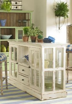 Love this! Kitchen island made of reclaimed windows.