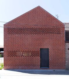 Half brick, half corrugated iron, this house in the northern French countryside aims to meld together the local urban and agricultural typologies.