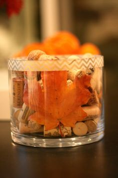 Easy coffee table decor - Adding a leaf to a jar of wine corks as easy fall coffee table decor