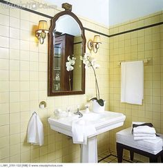 cream and white bathrooms | BATHROOMS: 1920s style. Detail of white stately pedestal sink in ...