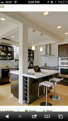 Open concept kitchen with support pole