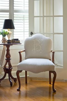 love this monogrammed chair with the lovely side table and lamp - great style!