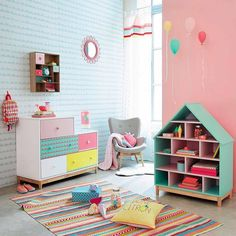 Pink and aqua playroom with loads of fun storage ideas for toys and books.  Love everything about this room