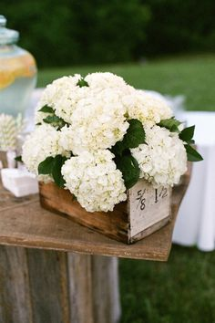 Pretty hydrangea centerpiece in a wooden box for rustic wedding decor. This is perfect, then using pops of colors with cut flowers in jars mixed throughout Wooden Wedding Centerpieces, Flower Centerpieces, Flower Arrangements, Wedding Decorations, Centrepieces, Centerpiece Ideas, Floral Arrangement, Southern Weddings, Rustic Weddings