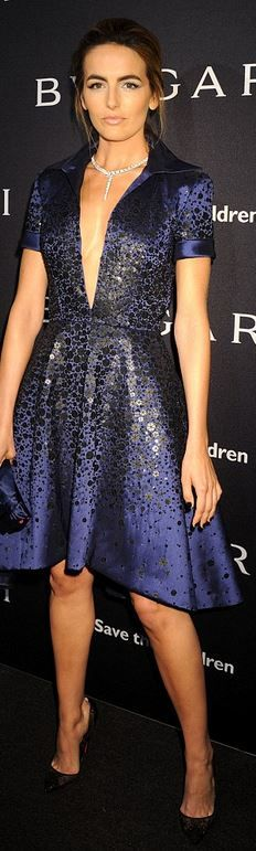 Who made Camilla Belle's jewelry, blue dress, clutch handbag, and black pumps…