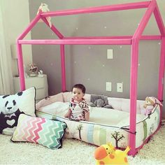 .pink wooden house shaped toddler first bed great for playing during the day and wide and big enough for sleepovers