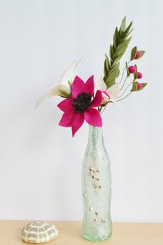 The Josephine Felt flower bouquet will brighten any room with it's white, magenta, and brown flowers. It is accented by felt foliage in a soft moss green color. The Josephine Bouquet would make the perfect house warming gift, a wonderful addition to an office desk, or even as a bride's bouquet.