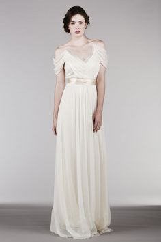 HB6285 l This romantic, sheer V-neck dress is a reinvention of one of our classic favorite styles. The added drama, with ever so softly dropped shoulders, is in perfect harmony with the flowiness of the dress for truly effortless elegance.