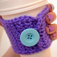 Crochet Coffee Cozy - Carry your coffee cup in style with this free crochet pattern. The large button is the perfect finishing touch.