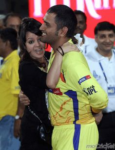 Sakshi doesn't refrain from going alongside her hubby everywhere to support him. For rare pictures of this lovey dovey couple click http://mocricket.com/
