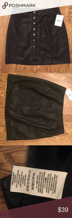 NWT Free People Vegan Leather Black Skirt NWT.  vegan leather.  free people.   Buttons up the front. From top to bottom is 15.5 inches.  Super cool! Free People Skirts Mini