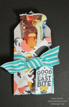 2014 Using Stampin' Up!'s Envelope Punch Board and the Motley Monsters designer series paper, made this fun treat pouch for Halloween. fill it with a Hershey bar