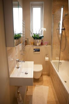 Small bathroom ideas and small bathroom designs for both city and country homes. From small bathroom designs using tile and wallpaper, to help decide on a small bathroom layout. Tiny Bathrooms, Tiny House Bathroom, Amazing Bathrooms, White Bathrooms, Small Space Design, Bathroom Design Small, Small Spaces, Bathroom Designs, Modern Bathroom