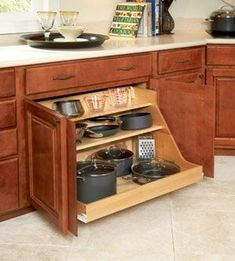 A pull out drawer for pots and pans! http://www.dongardner.com/. #Kitchen #Storage #Organization