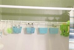 "DIY Organization-Another ""mini-crate"" idea. Add a 2nd shower rod to hang all those extra shower & bath items. If you really want to go crazy with shower rods, you can add one to dry towels and swimsuits, too."