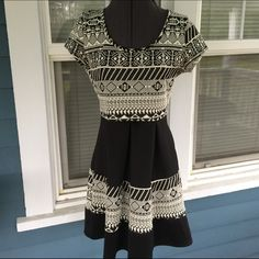 "CHARLOTTE RUSSE Tribal Print Dress CHARLOTTE RUSSE Tribal Print Dress.  Cap sleeves.  Pleated skirt. Keyhole adorned back neckline.  Black & cream stretchy  tribal print polyester/spandex blend material.   Shoulder width 14"". Length 33-1/2"" (shoulder to hem).   Excellent condition. Charlotte Russe Dresses"