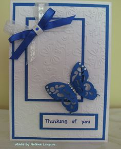 Blue butterfly on embossed backgrounds